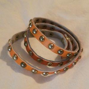 Jewelry - Orange and goldtone wrap bracelet.